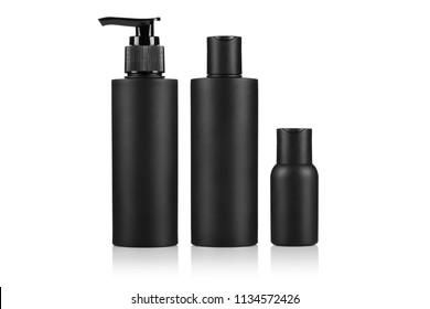 Set of black plastic bottles, isolated on white background