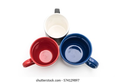 Set of black, red and blue cups on white background