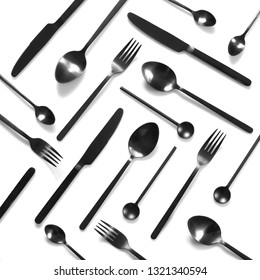 Set of black steel cutlery on white background. Top view point.