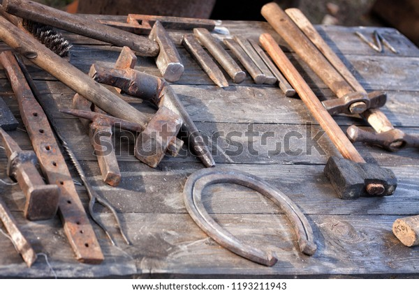 Set Blacksmith Tools On Wooden Table Stock Photo (Edit Now) 1193211943