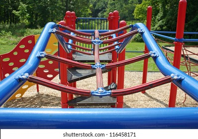 A set of blue bars in an empty playground