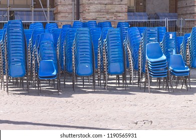 A set of blue chairs on the street (Marche, Italy, Europe)