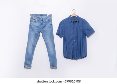 Set of blue denim jean with shirt on hanging isolated