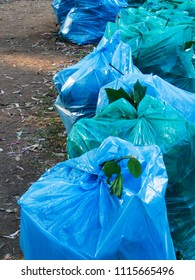 A set of blue garbage bags