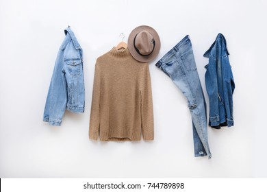 Set of Blue jeans and jacket , sweater clothes on hanger