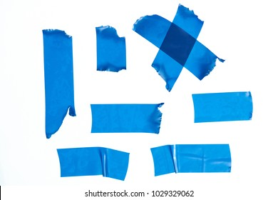 Set of blue masking tape pieces isolated on white background