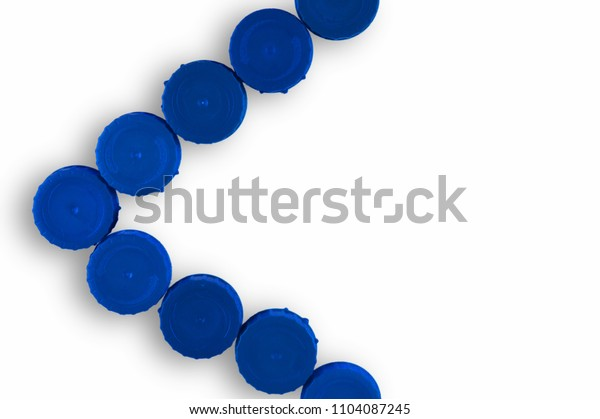 set of blue plastic plugs on white background forming the less than sign