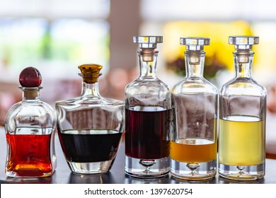 Set of bottles with home made tasty liqueurs inside.