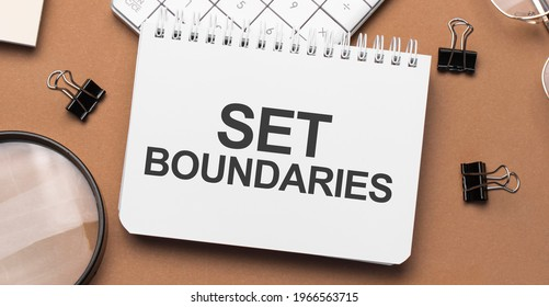 set boundaries on notepad with pen, glasses and calculator