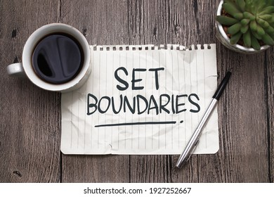 Set boundaries, text words typography written on paper against wooden background, life and business motivational inspirational concept