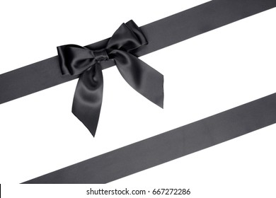 Set of bow and black silk ribbons