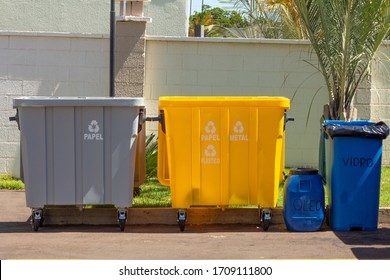 Set of boxes for selective waste collection (glass, paper, metal, organic and plastic) for recycling purposes. Colored trash for condominiums and buildings