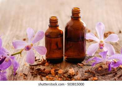 Set of branch purple orchid with massage oil on old wood
