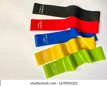 Set of bright multi-colored latex rubber bands for fitness on a white background.  sports concept.  fitness trend.  top view, flat lay, copy space. - Shutterstock ID 1670955322