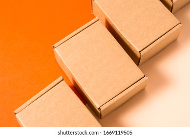 Set of brown cardboard boxes on colorful background