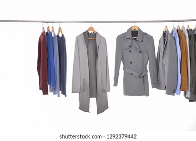 Set of brown jacket ,coat sweater with belt, skirt, handbag on hanger