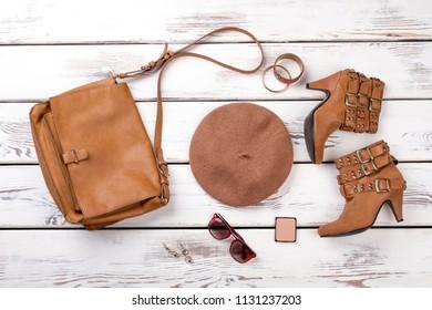 Set of brown summer women's accessories. Flat lay, top view. Clothing arrangement.