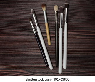 set brush on a dark wooden background