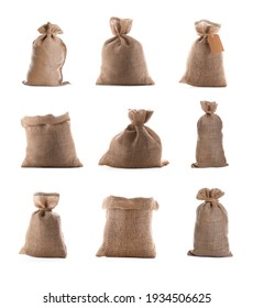 Set with burlap bags on white background
