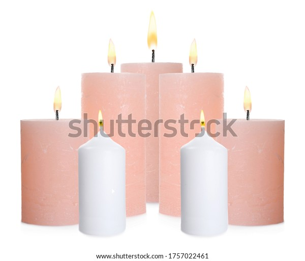 Set of burning color candles on white background