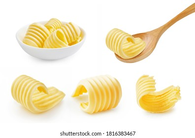 Set of butter curl on wooden spoon. Butter roll in white bowl isolated on white.