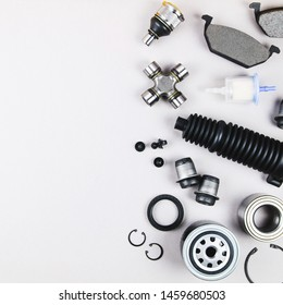 Set of car parts for maintenance on grey background