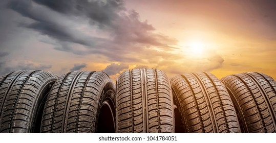 Set of car wheels on sunset background.