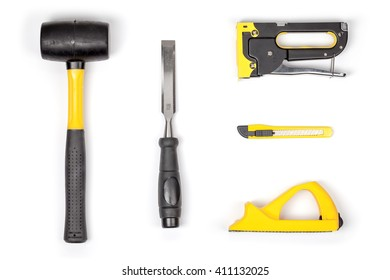 set of carpentry tools on white background with copy space top view. carpenter working table. carpentry and woodwork industry flat lay concept