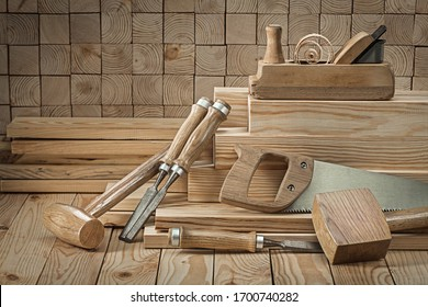 set of carpentry tools wooden mallets chisels woodworking planner on wood background