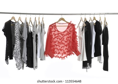 Set of casual fashion clothing hanging on hangers