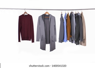 Set of casual men's clothes shirts ,suit, coat,sweater on hangers