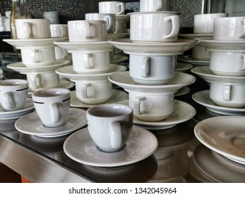 Set of ceramic cups and saucers