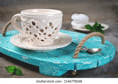 Set of ceramic tableware on a wooden tray. Kitchen interior
