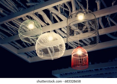 set of chandelier as cage with lamp. photo