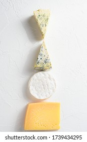Set cheeses. parmesan , blue cheese, , brie cheese. Top view. On a white background. Free copy space.
