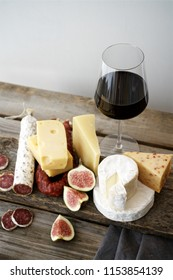 Set of cheeses and salami on rustic wooden table. Snacks for wine