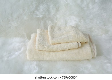 Set of Children's towel on white fur.