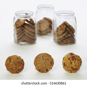 Set of Chocolate Chip Cookie in glass bottle on white background with nuts, almond, white sesame seeds, cornflake