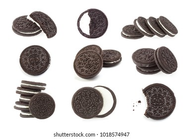 A set of chocolate cookies and cream isolated on white background