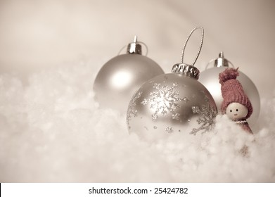 Set of Christmas balls and an elf on fake snow with antique colors.