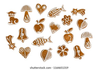 Set of Christmas and New Year gingerbreads. Collection of sweet hand-decorated pastries with aromatic flavor. Cute confections of various shapes. Traditional sweets. Isolated on white background.