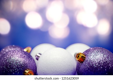 Set of Christmas tree decorations on festive bokeh background with copytext space above