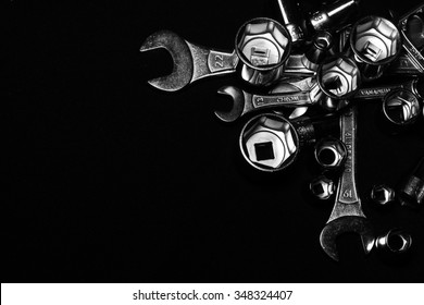 Set of chrome wrenches on black background. Close up.