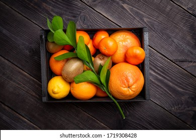 A set of citrus fruits to enhance immunity in a black box on a dark background. The concept of raising immunity. Top view - Shutterstock ID 1719308428
