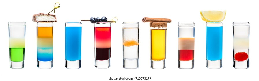 Set of classic alcoholic cocktails in shot glasses (shooters) isolated on white