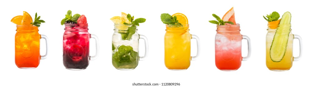 Set of classical fresh delicious lemonades in a vintage mason jars isolated on white background. Ideas for summer cocktails. Healthy fruit and berry drinks