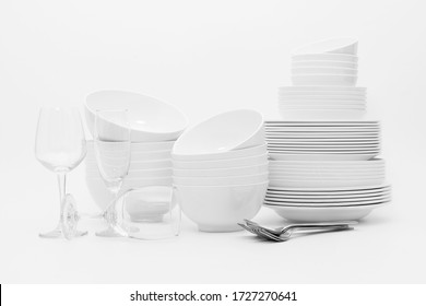 set clean dishes glasses on white background