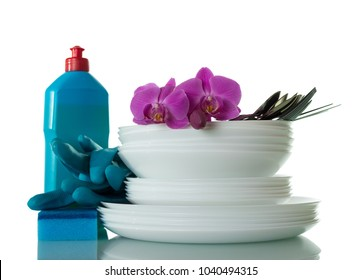 Set of clean plates and Cutlery, detergent, sponge and gloves isolated on white