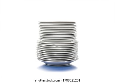 Set of clean plates isolated in white. Stacked kitchen tableware.  Element or component for design