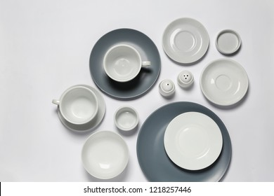 Set of clean tableware on white background